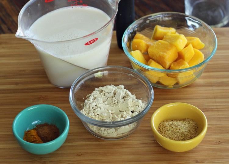 Mango Chai Protein Smoothie Ingredients Almond Milk Flaxseed Turmeric Cinnamon | www.artfuldishes.com