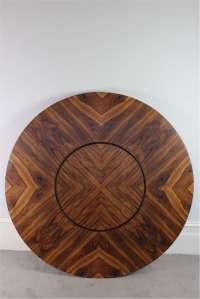 Merrow Associates circular Rosewood dining table with lazy ...