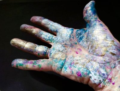Messy hands covered in paint after a great painting session