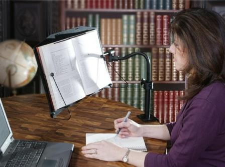 LEVO Bookholder clamps to desk enables hands free reading