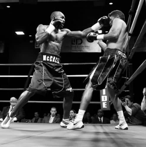 professional boxers fighting in a ring