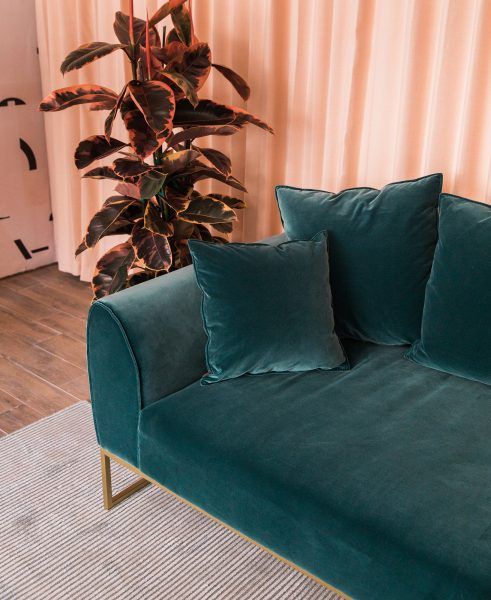 small living room sofa color curved sectional amazon how to choose a for your articulate we love the pink and teal combo in this citysage design looking good kits pacific blue