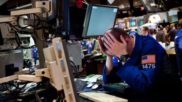 NYSE trader holding head