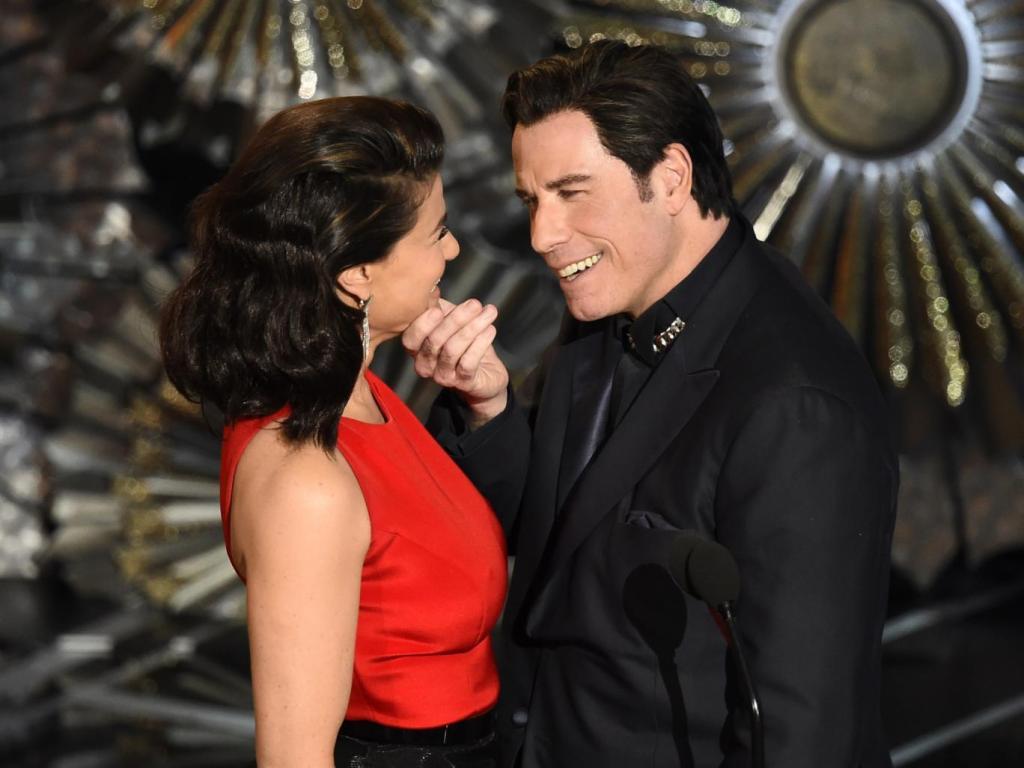 John Travolta touching Idina Menzel's face at the 2015 Oscars, (Independent).