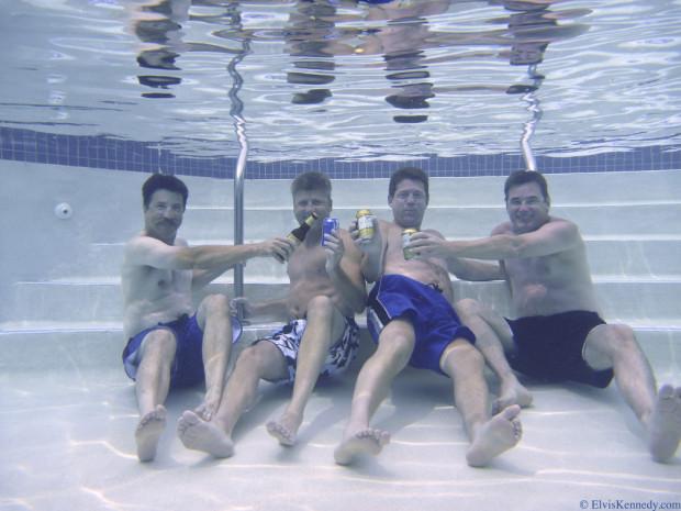 stoner: Swimmers underwater holding beers