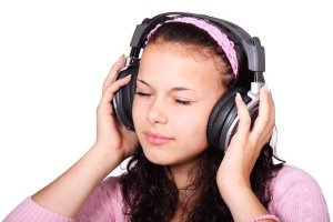 A girl listening to a piece of music.