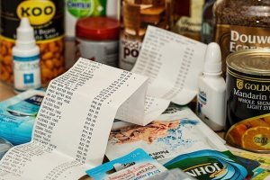 Various groceries and a long receipt for them.