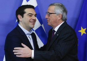 epa04603088 European Commission President Jean-Claude Juncker (R) welcomes Greek Prime Minister Alexis Tsipras prior to a meeting at the EU Commission headquarters in Brussels, Belgium, 04 February 2015. Greek Prime Minister Alexis Tsipras arrived in Brussels on 04 February as part of his tour of European capitals to press their demands for debt relief.  EPA/OLIVIER HOSLET