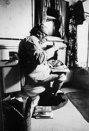 Charles Bukowski having a nice read on the shitter