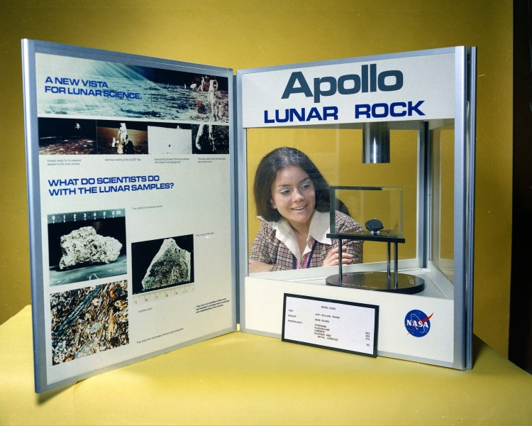 Miss NASA 1973 (Merri C. Fahnenbruck) with the Apollo lunar rock display
