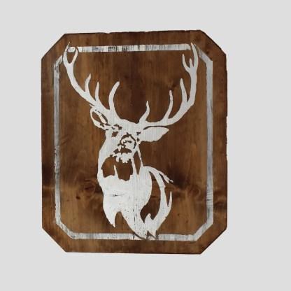 tavola in legno vecchio decorata con silhouette cervo in foglia d'argento.
