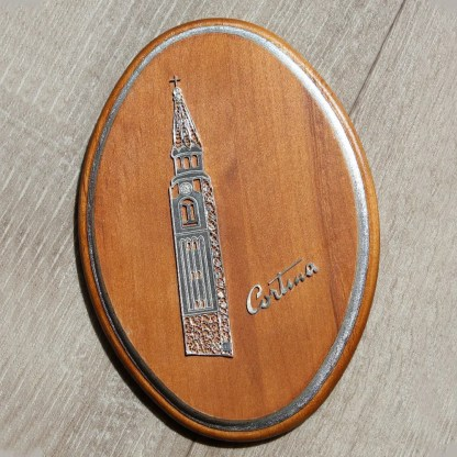 ovale in legno con bordo in foglia d'oro con campanile Corina d'Ampezzo in filigrana d'argento