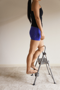 Tiffany Kadani of Dancing Branflakes demonstrates a calf stretch from a step stool