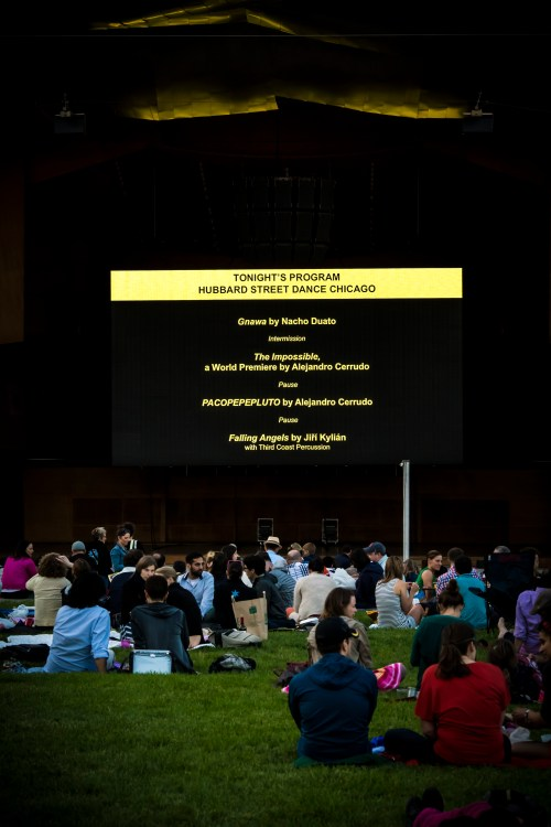 Pre-performance slide onscreen in the Jay Pritzker Pavilion in Millennium Park, June 6, 2014. Photo by Benjamin Wardell.