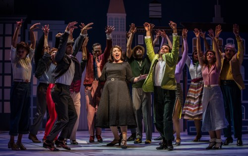 "Bri Sudia (Ruth) sings ""Swing"" along with ensemble members in Wonderful Town, a musical by Leonard Bernstein, librettists Joseph A. Fields and Jerome Chodorov and lyricists Betty Comden and Adolph Green. Directed by Manilow Resident Director Mary Zimmerman at Goodman Theatre (September 10 - October 16, 2016)."