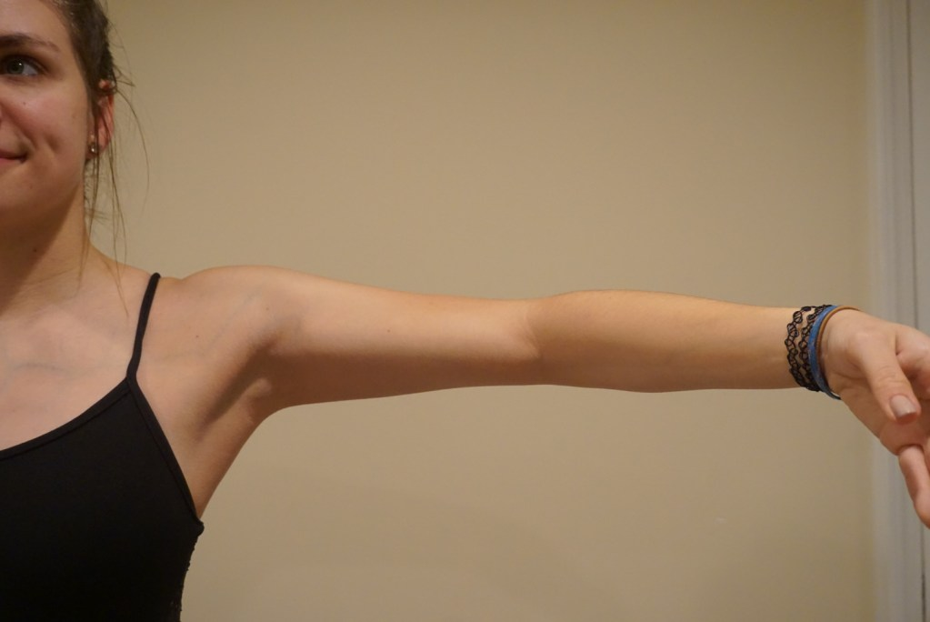 Correct placement of arm in second position includes medial rotation of the glenohumeral joint.