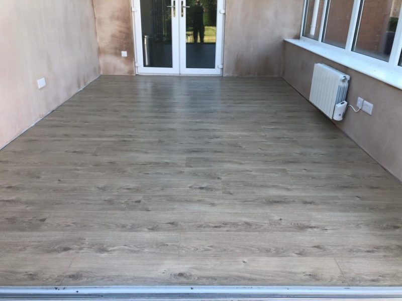 Traditional laminate flooring fitted to a Preston customers conservatory