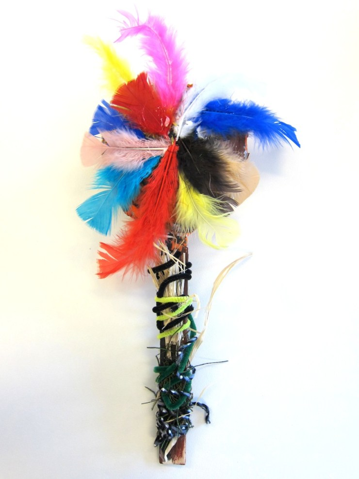 rattle with feathers and yarn
