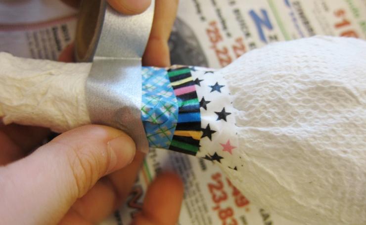 Putting Washi Tape on the maraca
