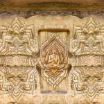 yoga-symbal-in-stone-wall