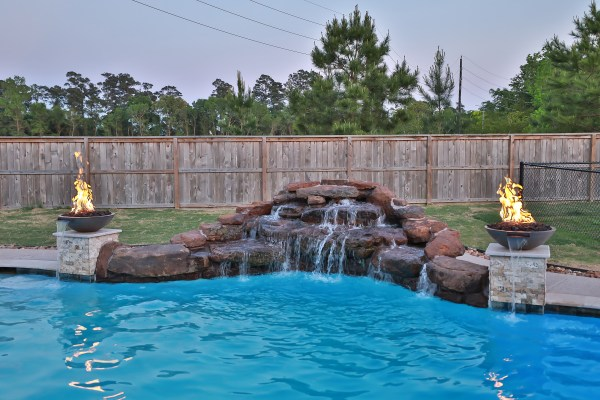waterfall, fire bowls, freeform pool, houston pool builder, chattanooga pool builder