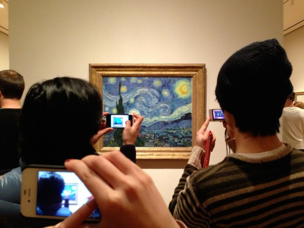 Person Taking Picture at Museum