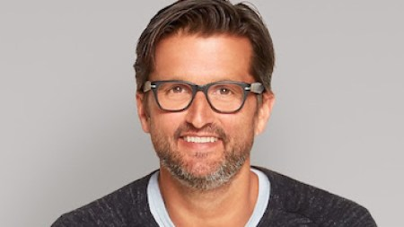 Designer John Christakos Named President of