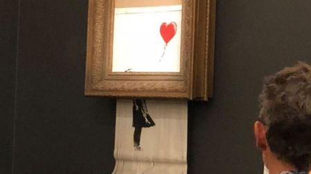 Banksy Painting Self-Destructs After Selling $1.4