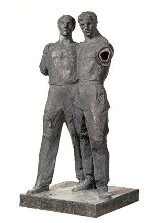 A bronze statues of two men standing united. The sculpture has been damaged and the figures are missing limbs