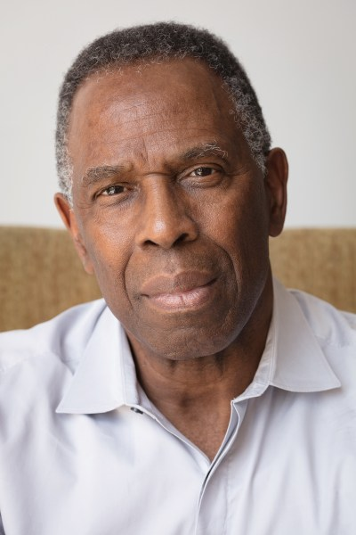 Portrait of Charles Gaines, who is wearing a white collared shirt.