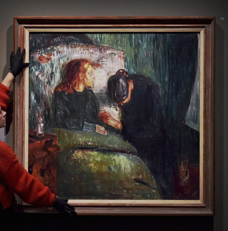 Edvard Munch: love and angst exhibition. A staff member adjusts The Sick Child (1907) during a preview for the Edvard Munch: love and angst exhibition at the British Museum, central London. Picture date: Monday April 8, 2019. Photo credit should read: Nick Ansell/PA Wire URN:42220258 (Press Association via AP Images)