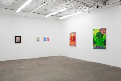 Five works—two paintings, two drawings, and one diptych—are arranged in one corner of a white cube gallery. They vary dramatically in size and include all the colors of the rainbow, but the bright neon painting to the right stands out.