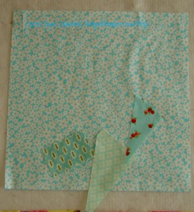 Choose fabrics by putting scraps on background
