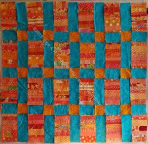 Orange Strip Donation Top with cut sashing