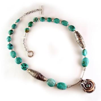 Turquoise necklace with Tibetan silver cones and pendant