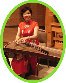 Performer Qin Xiao Ning demonstrates on the Chinese guzheng.