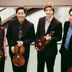 Members of the Ying Quartet smiling and looking at the camera.