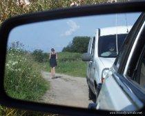53816-belarusian-country-girl-in-the-rear-view-mirror-braslav-lakes-belarus.jpg