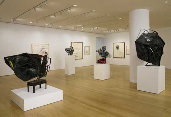 Sotheby's installation shot of Dia's Chamberlains (on pedestals) and Twomblys (on walls) to be auctioned in November