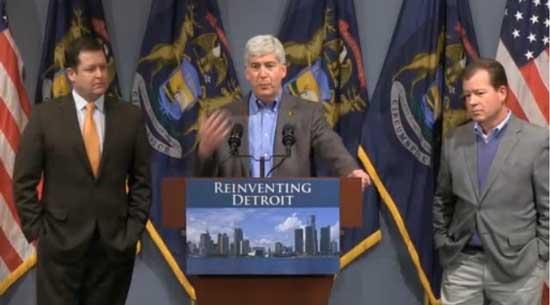 Michigan Gov. Rick Snyder, flanked by House Speaker Jase Bolger (l) and Senate Majority Leader Randy Richardville (r)     Screenshot from press conference webcast