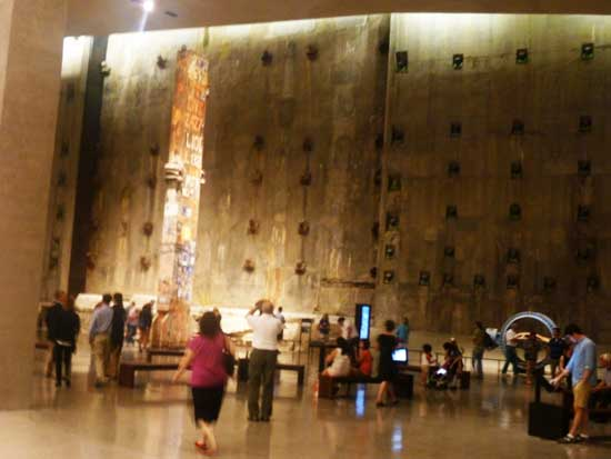 "The ""Last Column"" against backdrop of the slurry wall at 9/11 Memorial Museum Photo by Lee Rosenbaum"