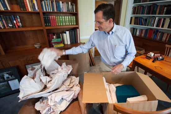 Time to pack up again? Dan Weiss unpacking cartons in his then new Haverford office, July 2013
