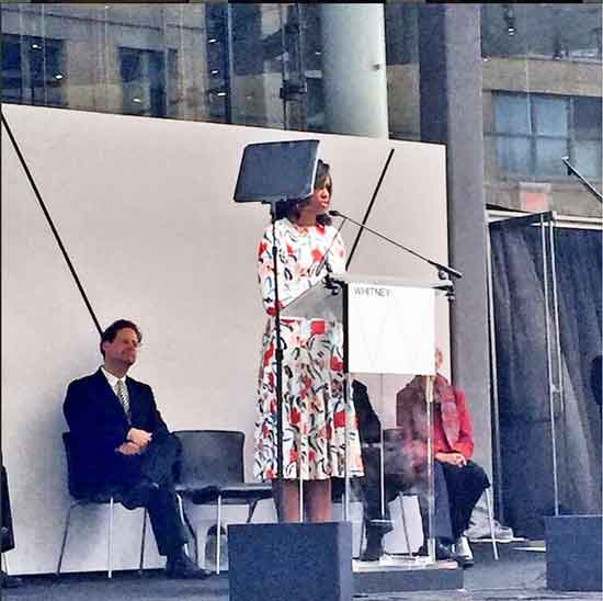 Michelle Obama addresses attendees at Whitney's ribbon-cutting, while director Adam Weinberg looks on Photo from the Whitney's Instagram page