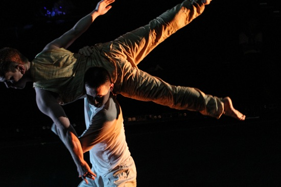 Kevin Ho lifting Jeffrey Duval in Tiffany Mills' The Feast (Part 1). Photo: Julie Lemberger