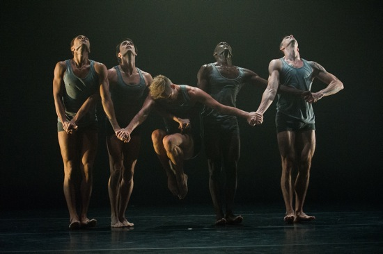 Graham dancers (L to R), Abdiel Jacobsen, Maurizio Nardi, Lloyd Knight, and Ben Schultz hold Tadej Brdnik in Rust. Photo: Christopher Duggan, courtesy of Jacob's Pillow