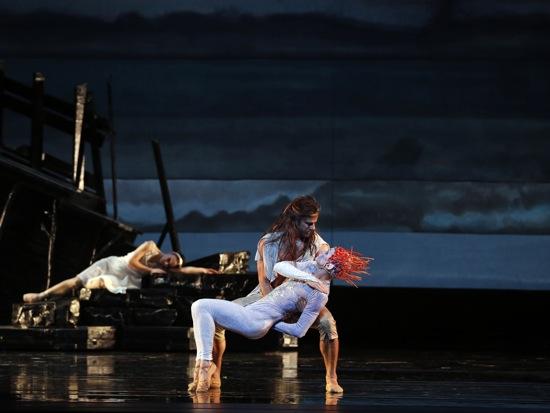 Prospero deals with Ariel. Miranda sleeps. The first-night cast of Alexei Ratmansky's The Tempest: Marcelo Gomes holding Danil Simkin, Sarah Lane at back. Photo: Marty Sohl