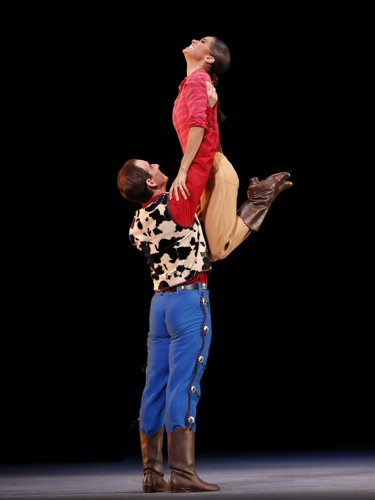 Craig Salstein as the Roper hoists Misty Copeland as the Cowgirl in de Mille's Rodeo. Photo: Marty Sohl