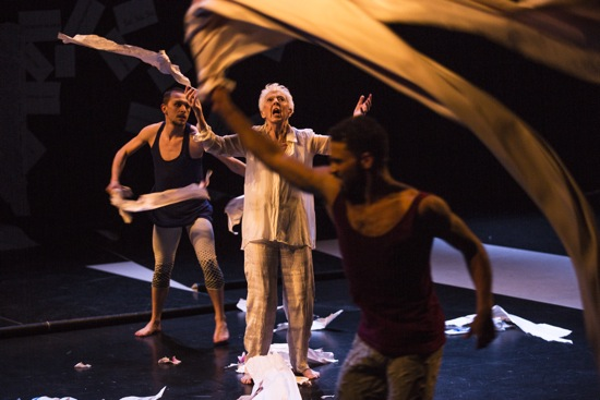 John Scott and Valda Setterfield's Lear. King Lear (Setterfield) besieged by a storm: Kevin Coquelard (L) and Marcus Bellingham. Photo: Maria Baranova