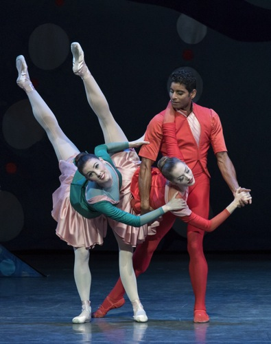 Amar Ramasar assists Tiler Peck (L) and Unity Phelan in Christopher Wheeldon's American Rhapsody. Photo: Paul Kolnik