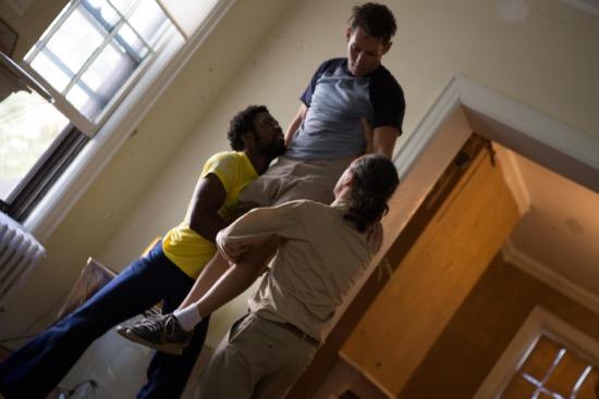 Men at play: Oluwdanilare (L) and Pedro Osorio hoist Darrin Wright. Photo: Julia Discenza